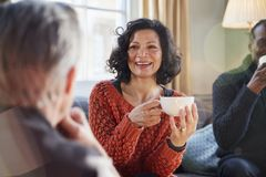 Free Middle Aged Woman Meeting Friends Around Table In Coffee Shop Stock Photo - 113665400