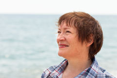 Middle-aged woman  near  sea. Stock Image