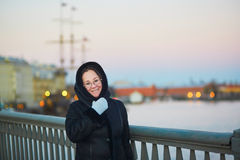 Middle aged woman on the Neva embankment in St. Petersburg, Russia Stock Photography