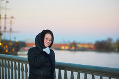 Middle aged woman on the Neva embankment in St. Petersburg, Russia Stock Photos