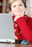 Middle-aged woman and notebook royalty free stock images