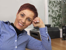 Middle-aged  woman at the office Stock Images