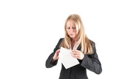 Middle aged woman opens a letter Stock Photo