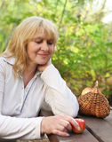 Middle aged woman outdoors Royalty Free Stock Images
