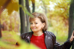 Middle-aged woman outdoors in the park Royalty Free Stock Photography