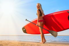 Woman with paddle board stock photography