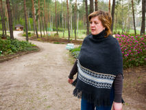 Middle-aged woman in a park Stock Photography