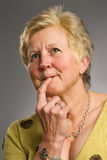 Middle-aged woman with pensive expression Stock Images