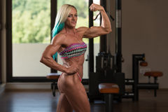 Middle Aged Woman Performing Rear Double Biceps Pose Royalty Free Stock Photos
