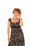 Middle aged woman on phone Royalty Free Stock Photography