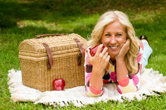 Middle aged woman on picnic Royalty Free Stock Image