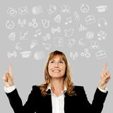 Middle aged woman pointing media icons. Smiling woman showing drawing and sketching icons vector illustration
