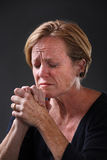 Middle aged woman praying Stock Photo