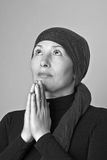 Middle aged woman praying Stock Image