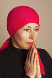 Middle aged woman praying Royalty Free Stock Images
