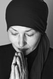 Middle aged woman praying Stock Photos