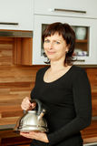 Middle-aged woman preparing coffee Royalty Free Stock Photo