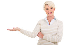 Middle aged woman presenting Stock Images