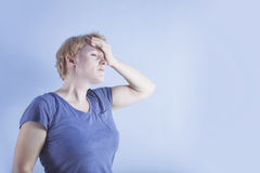Middle aged woman. Problems, headache. Middle aged woman. Problems, stress, headache, pain. Blue free space Royalty Free Stock Photos