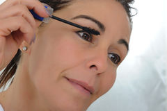 Middle aged woman put mascara Royalty Free Stock Photography
