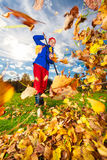 Middle aged woman raking leaves Royalty Free Stock Images