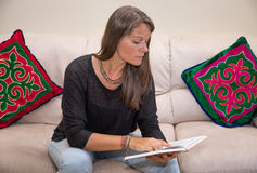 Middle aged woman reading a book. Stock Photography