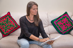 Middle aged woman reading a book. Stock Photo