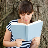 Middle-aged woman reading book Stock Images