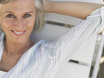Middle Aged Woman Reclining On Sunlounger Royalty Free Stock Images