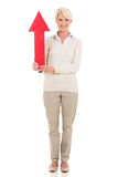 Middle aged woman red arrow Stock Photography