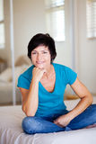 Middle aged woman relaxing Royalty Free Stock Image