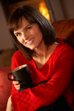 Middle Aged Woman Relaxing With Hot Drink Royalty Free Stock Photo