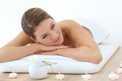 Middle-aged woman relaxing on massage bed Stock Photo