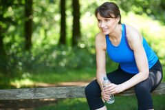 Middle Aged Woman Resting After Exercise Stock Photos