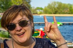 Middle-aged woman resting on the lake stock photography