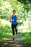Middle Aged Woman Running In Countryside Stock Photo