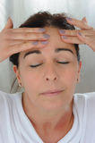 Middle aged woman self massage Stock Image
