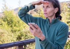 Middle aged woman shielding eyes Royalty Free Stock Photography