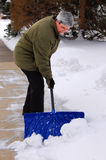 Middle aged woman shoveling Stock Image