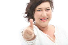 Middle-aged woman shows the cheerful thumbs up Royalty Free Stock Photos