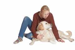 Middle aged woman sitting with the Golden Retriever dog Royalty Free Stock Photography
