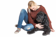 Middle aged woman sitting with the Schnauzer dog Stock Photography