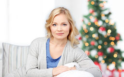 Middle aged woman sitting on sofa at christmas Royalty Free Stock Photo