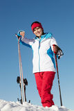 Middle Aged Woman On Ski Holiday In Mountains Royalty Free Stock Image
