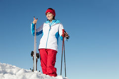 Middle Aged Woman On Ski Holiday In Mountains Royalty Free Stock Photography