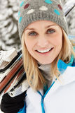 Middle Aged Woman On Ski Holiday In Mountains Royalty Free Stock Photo