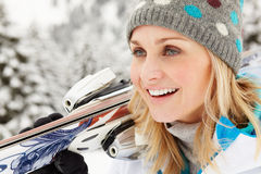 Middle Aged Woman On Ski Holiday In Mountains Stock Image