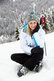 Middle Aged Woman On Ski Holiday In Mountains Stock Photo