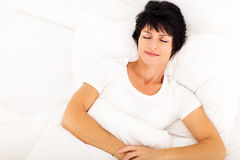 Middle aged woman sleeping Stock Photos