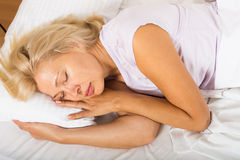 Middle-aged woman sleeping in bed Royalty Free Stock Photo